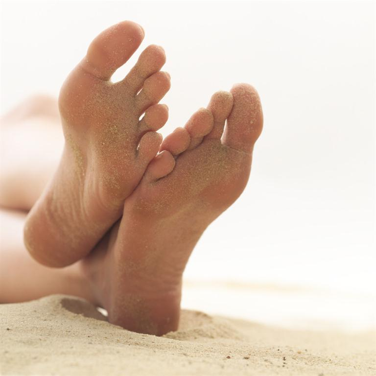 picture of feet on a sandy beach